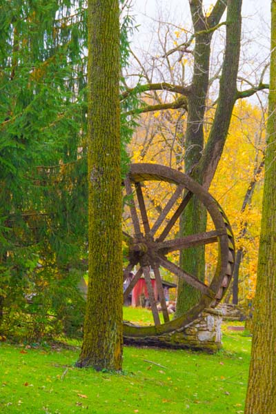 water wheel;Mill;Carrol County;Indiana;Midwest;fall colors;leaves;orange;green;yellow;vertical